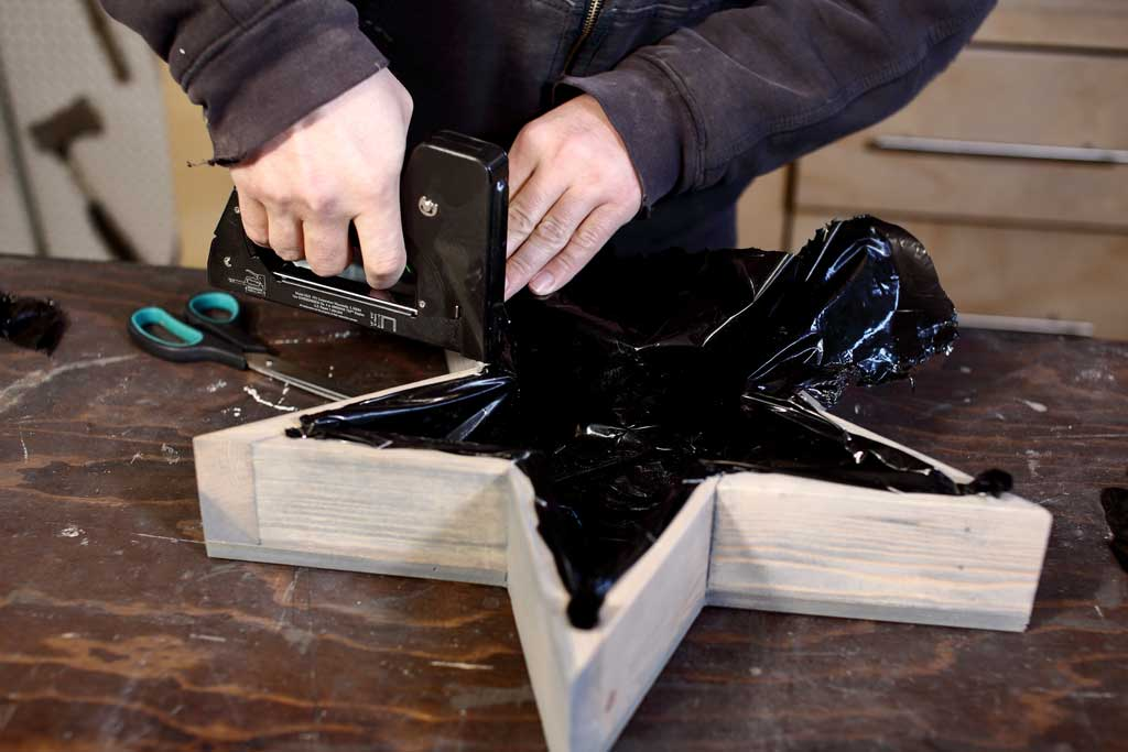 attaching plastic sheeting inside the planter