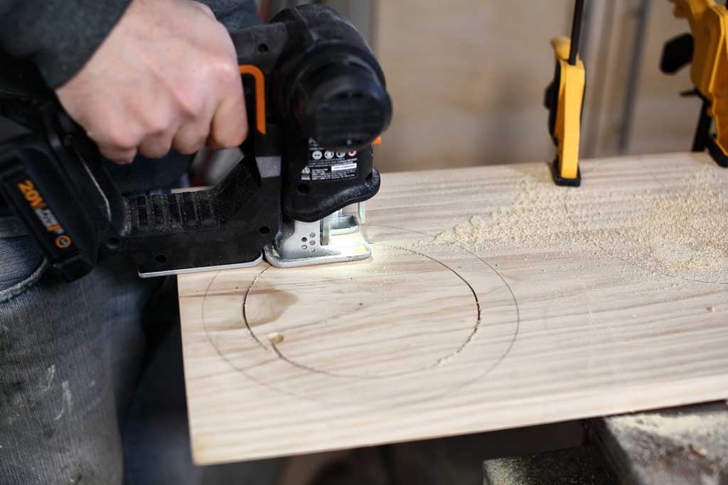 cutting out circle with jig saw on wood
