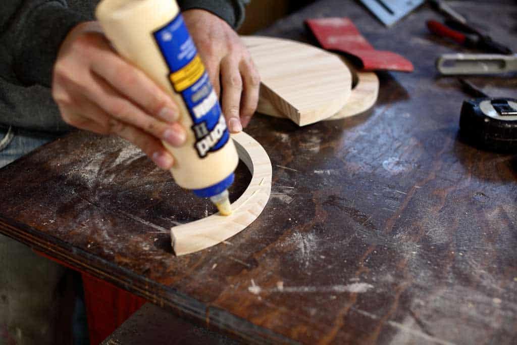 applying wood glue on wood
