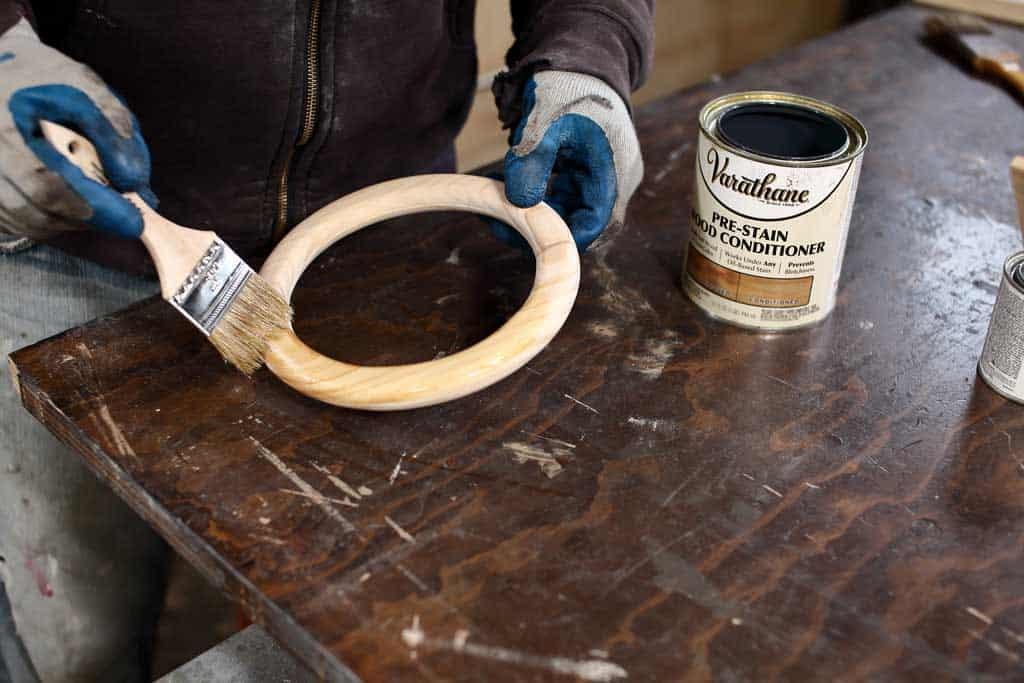 applying pre-stain on wood