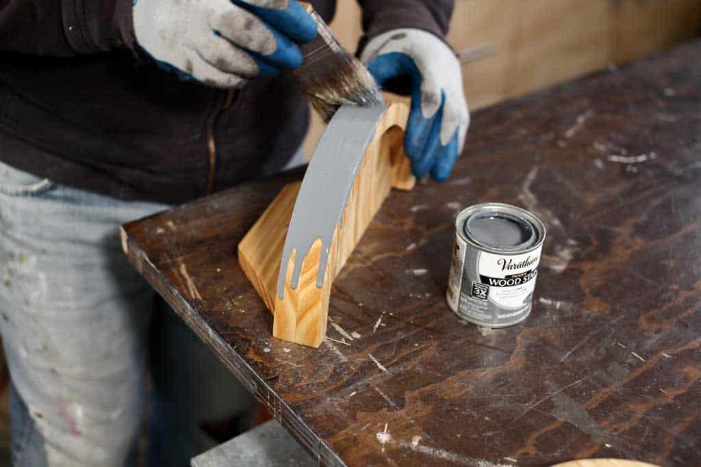 applying wood stain on wood