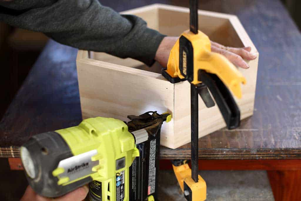 using nail gun to attaching honeycomb shelf