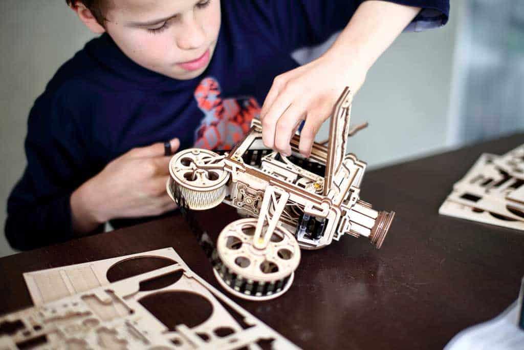 Boy building 3D puzzle