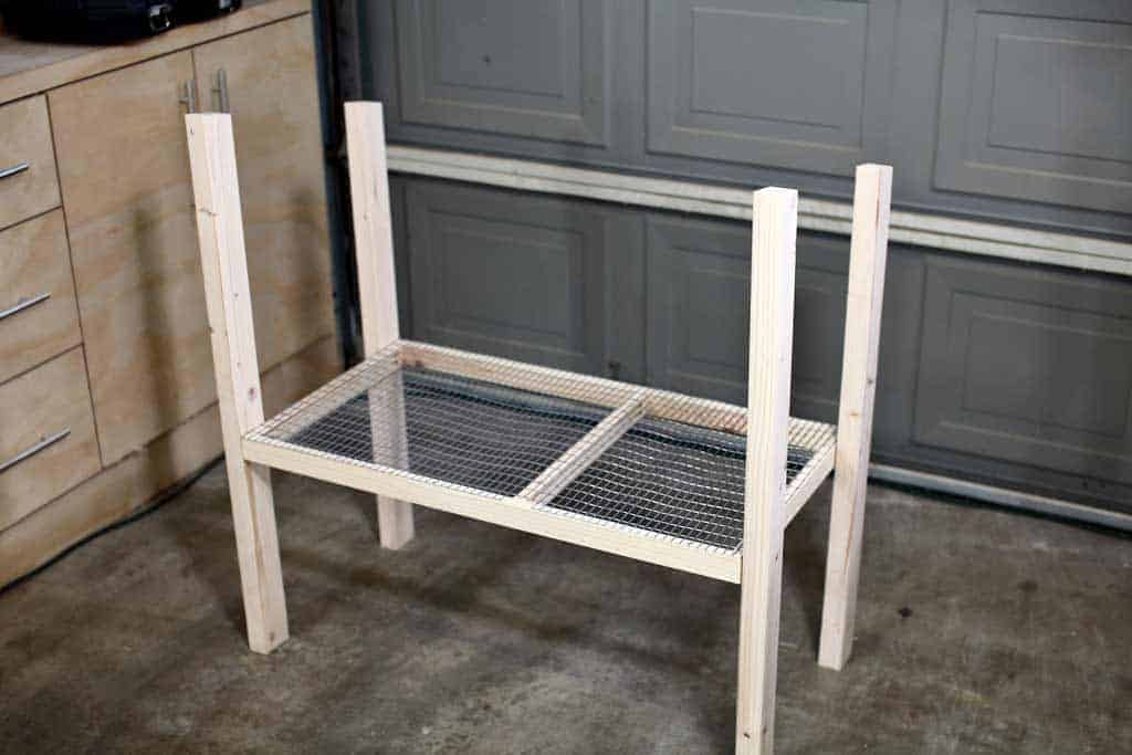 attaching floor to legs of the DIY rabbit hutch
