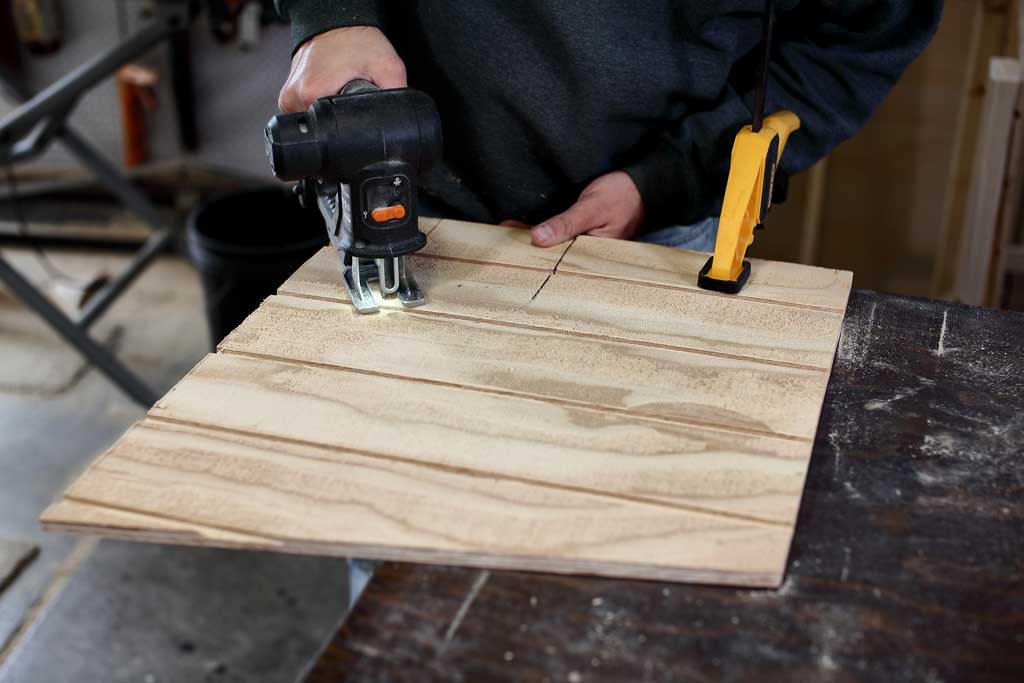 using jig saw to cut out opening in middle divider