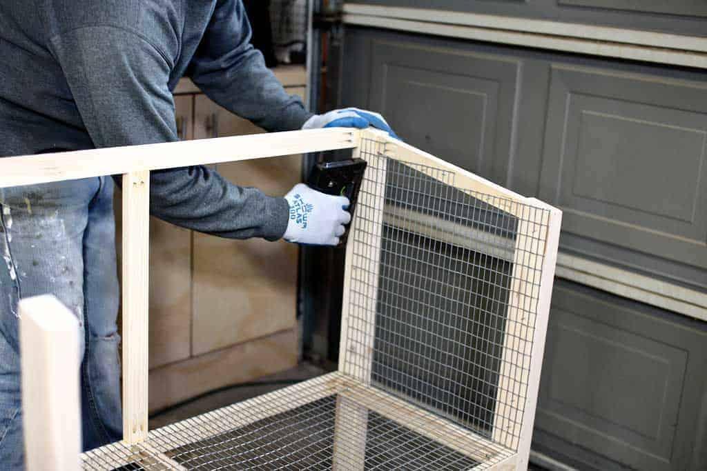 stapling wire mesh screen to DIY rabbit hutch