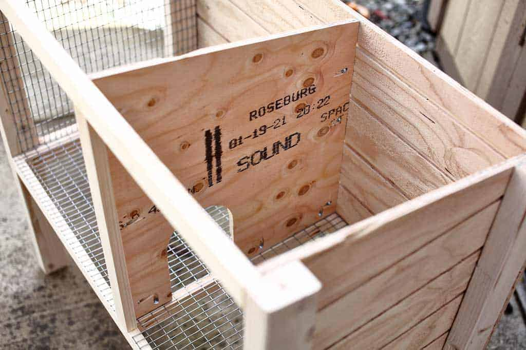 attaching middle divider of the DIY rabbit hutch