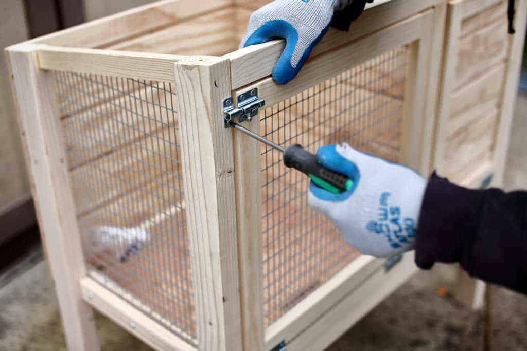 attaching door locks to the DIY rabbit hutch