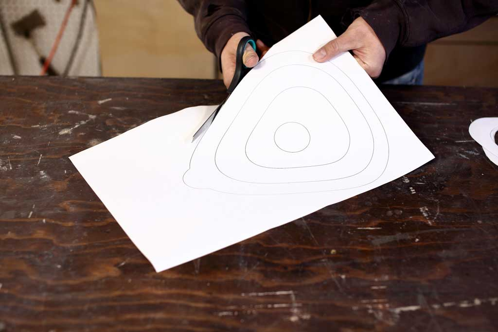 cutting birdhouse shapes with scissors