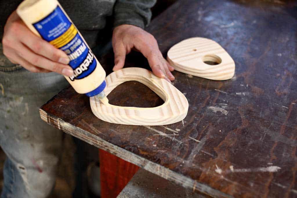 applying wood glue to board