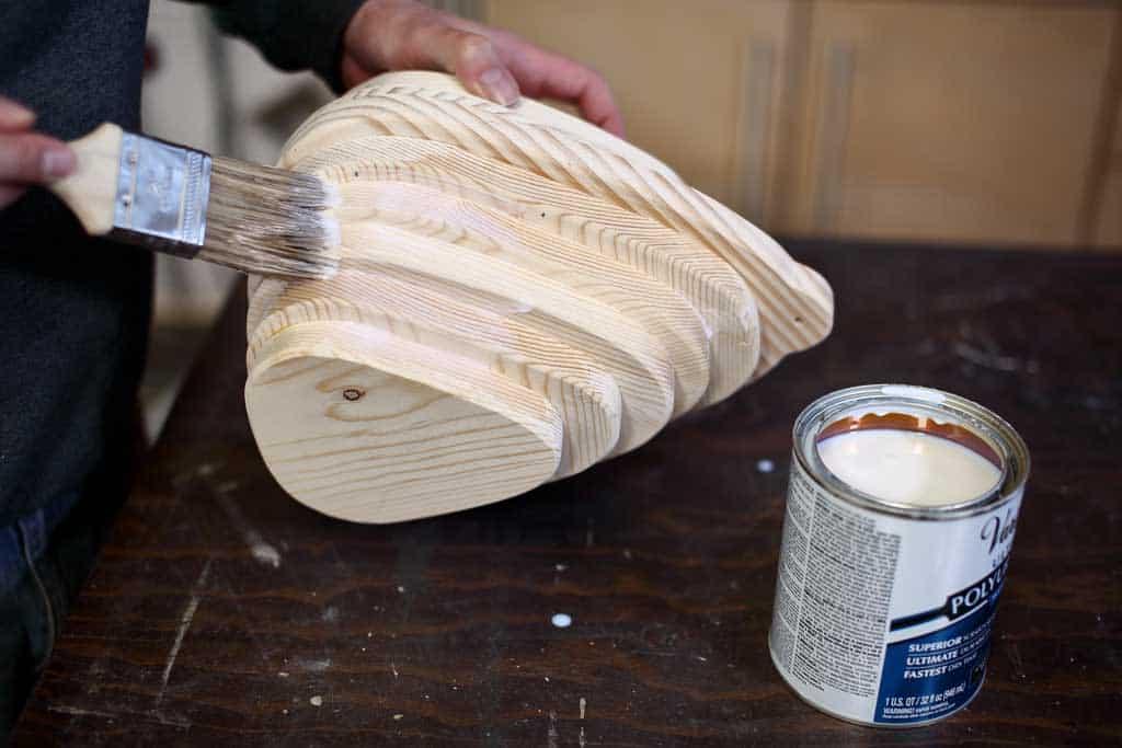 applying polyurethane to birdhouse