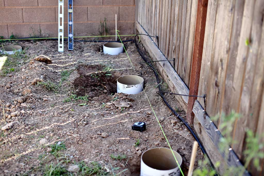 installing concrete tubes for concrete footings