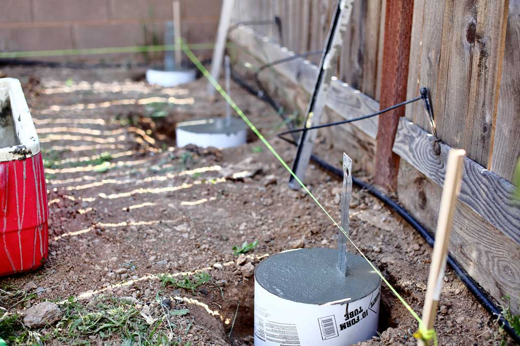 filling tubes with concrete for DIY Garden Arbor with a Bench
