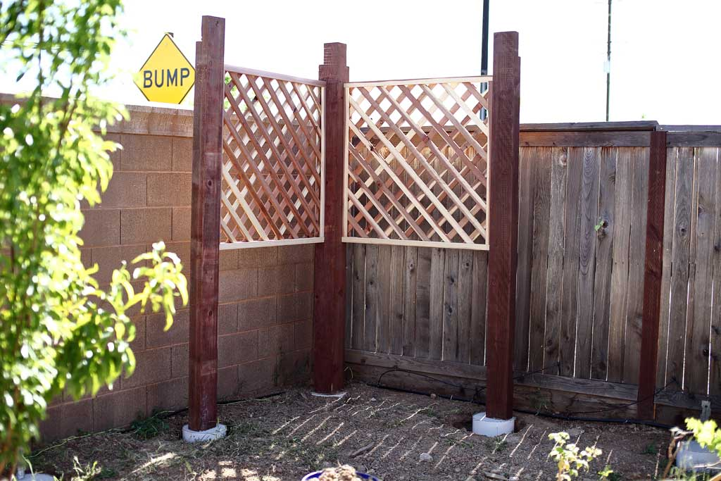 installing trellis panels for arbor