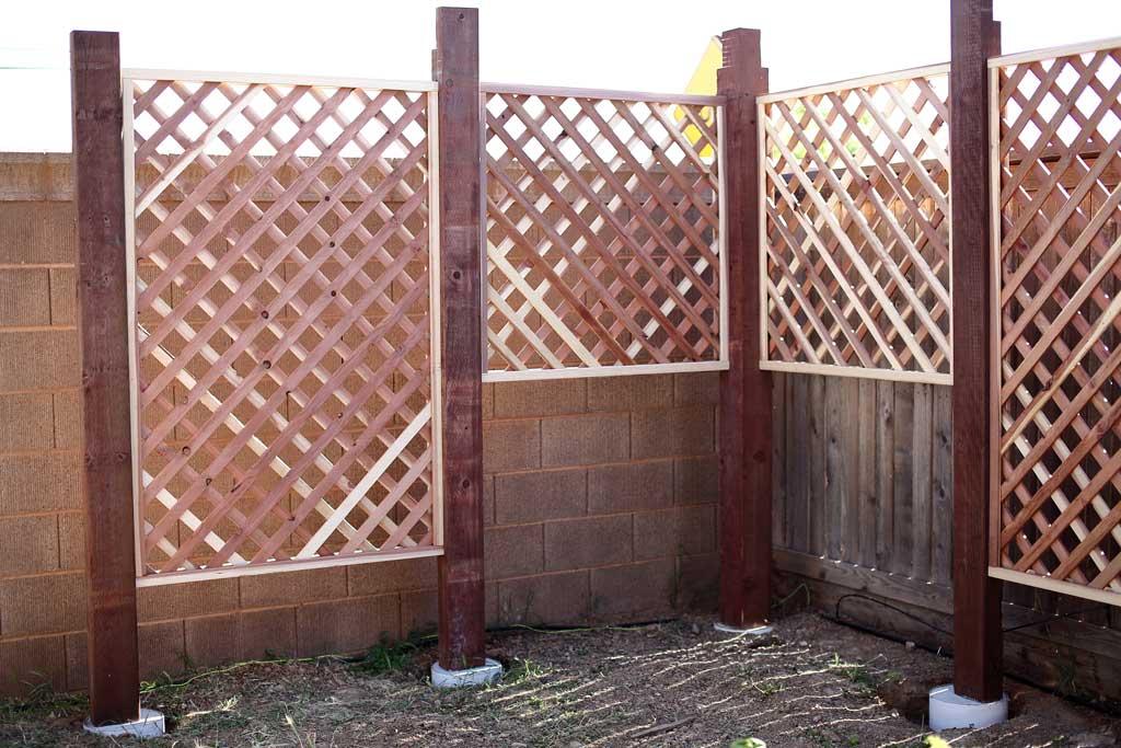 installing trellis for DIY Garden Arbor with a Bench
