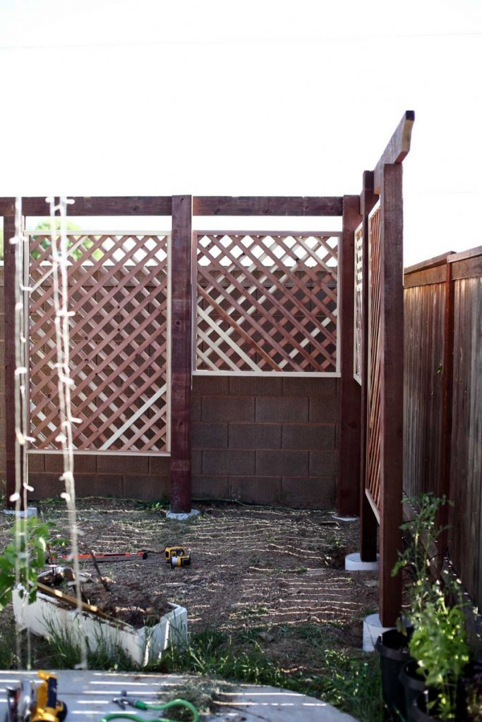installing roof boards for DIY Garden Arbor with a Bench