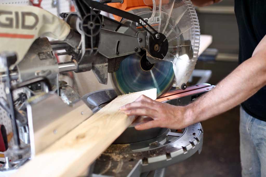using miter saw to cut wood