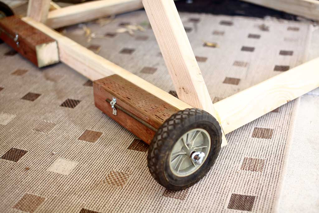 attaching wheels for DIY mobile triangle shape chicken coop