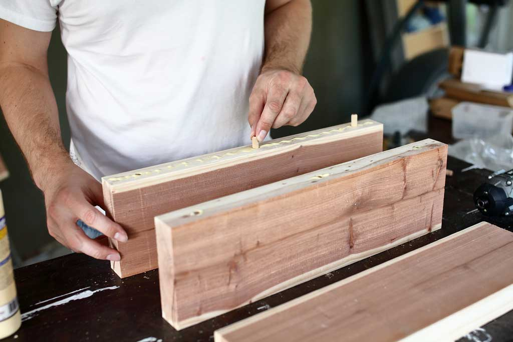 inserting dowels into the holes