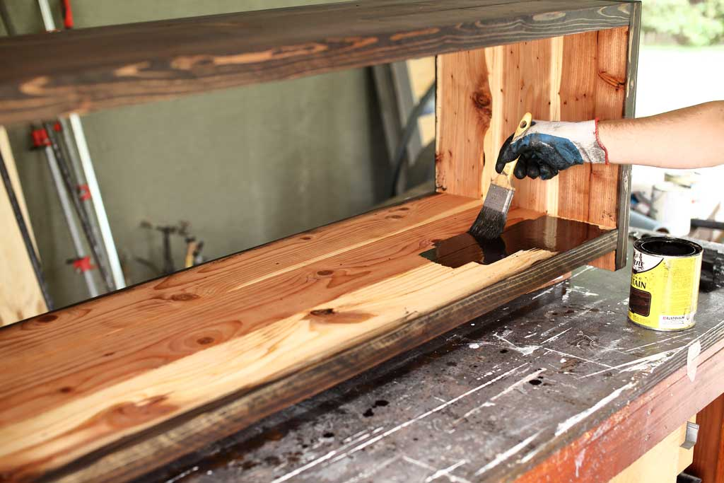 applying stain on bench wood